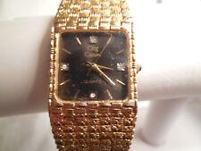 Oleg Cassini gold tone w/four diamond quartz watch