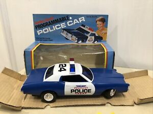 Vintage Radio Shack toy police car programmable in original box -