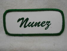NUNEZ  USED SILK SCREEN NAME PATCH TAG GREEN ON WHITE