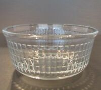 Small Clear Glass Bowl w/ Square Ribbed Inside the bowl.