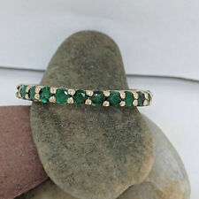 14kt Yellow Gold Band Green Emeralds set in a