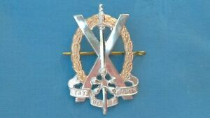 Staybright/Anodised.The Tayforth University Officer Training Corp cap badge.