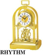 Rhythm 7744/9 Horloge de table Quartz Analogique Doré avec pendule rotative