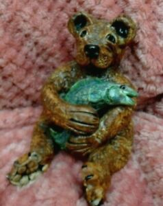 studio pottery Sculpture seated Grizzly  Bear holding a fish in his arms Rare