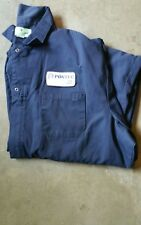 SIZE 60 REG X 29 COVERALLS; DRK BLU, 65/35% POLY/COTTON; LONG SLEEVES; PREOWNED