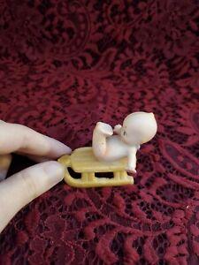 Vintage Unmarked Tiny Kewpie On A Sled Cute