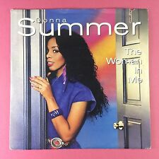 Donna Summer - The Woman In Me / Livin In America - WEA 25-9983-7 Italian Press