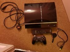 PlayStation 3 with controller headset and DVD remote control