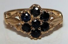 A FINE  9CT YELLOW  GOLD  SAPPHIRE FLOWER CLUSTER ENGAGEMENT RING SIZE N 1/2