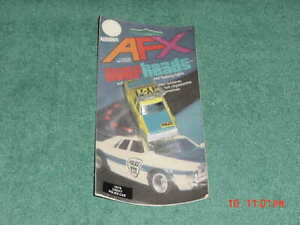 Aurora AFX overheads 1979 Chevy Police car NOS on Card Flashing Lights ! yellow