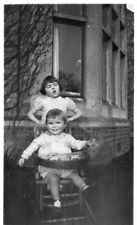 Small Photo of 2 Young Children outside a House, 1 in high chair (EPH)