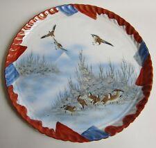 Japon. Kutani. Plat en porcelaine à décor d'oiseaux dans un paysage