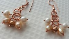 FRESHWATER CULTURED PEARLS AND COPPER EARRINGS.
