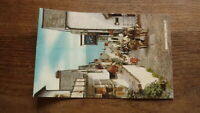 OLD POSTCARD OF BRITAIN, CLOVELLY CORNWALL, DOWN A LONG 1950s