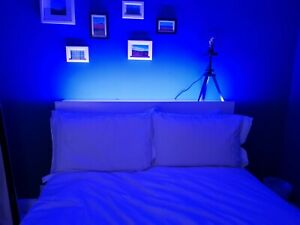 Double bed frame with storage drawers and shelves in the bed head and LED lights