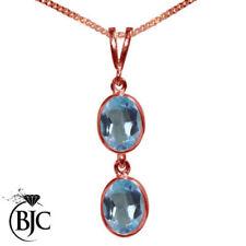 Collares y colgantes de joyería con gemas azules naturales topacio