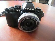 Olympus OM-D E-M10 + 3 Olympus M4/3 Lenses + 5 Batteries + Charger -133 shutter