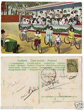 enfants multiples.vélos.cyclisme.sport.multiple children.bikes.cycling.chien.dog