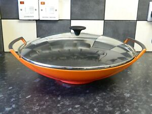 le creuset cast iron large  wok with lid in orange finish