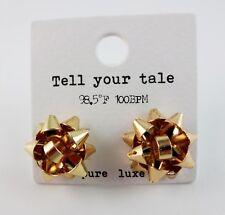 Gift bow earrings gold tone studs pierced ears