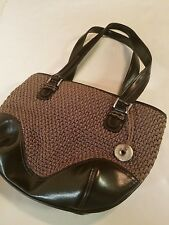 The Sac Brown woven shoulder handbag zipper close