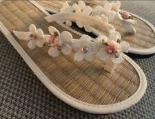 Ladies Straw Ivory Wedding Flip Flops decorated with lace and roses
