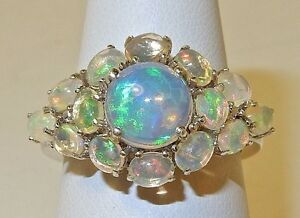 2.80 CTS. ETHIOPIAN WELO OPAL CLUSTER RING IN PLATINUM OVERLAY SS