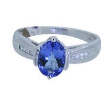 14KT White Gold Round Cut Diamond and Oval Tanzanite Fashion Ring 0.18 ctw