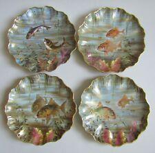 Limoges. Pouyat. 8 assiettes en porcelaine décor polychrome de poissons, XIXe