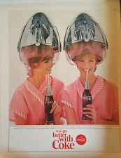 1965 Coca-Cola soda glass bottles women sitting under hair dryers pink curls ad
