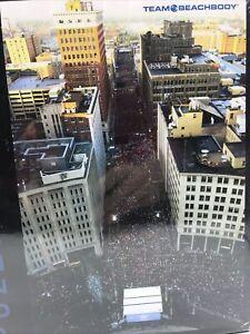 Team BeachBody 1500 Piece Jigsaw Puzzle Marathon Runners Downtown Cityscape