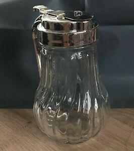 Glass Honey dispenser.