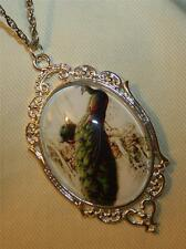 Lovely Heart Rimmed Elongated Sitting Peacock Cameo Silvertone Pendant Necklace