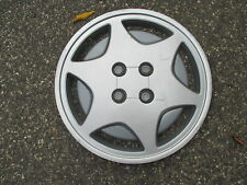 one 1993 to 1995 Saturn S series 15 inch bolt on hubcap wheelcover