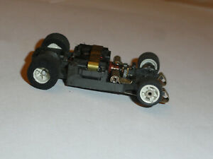 AURORA AFX G PLUS HO SLOT CAR CHASSIS WITH WHITE RIMS IN RUNNING CONDITION