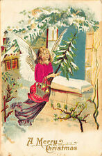 A Merry Christmas Satin Clothed Angel Carrying A Tree Window Embossed Postcard