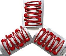Red hair clips in school colours. Set of 18 slides snaps sleepies bendies
