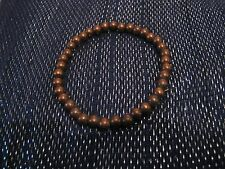 Wonderful simple small bronze/brown tone plastic beads elasticated
