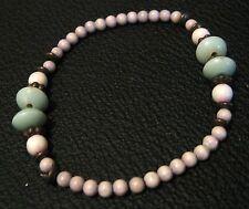 Lovely beaded elasticated bracelet with off white, green & bronze beads