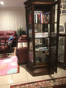 Large, very solid, sturdy  display crystal cabinet mirrored back , perfect con.
