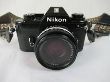 Vintage Nikon camera 35mm film SLR with 50mm lens old fashioned photography