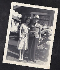 Vintage Antique Photograph Man & Woman in Cool Outfits Standing By Flowers