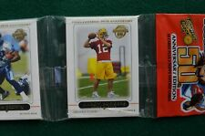Aaron Rodgers rookie card on front of 2005 Topps rack pack Green Bay Packers RC