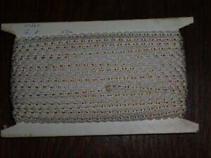 (0,30€/m) creme/weiß mit gelb Borte / Litze, Höhe ca. 1cm 50m auf einer Pappe