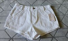 NWT FREE PEOPLE SHORTS. off white color. waist 26. embroidered pocket detailing