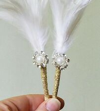 Great Gatsby wedding boutonniere with white feather and gold ribbon