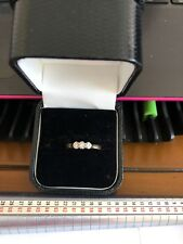 18 carat yellow gold diamond trilogy ring in size M1/2