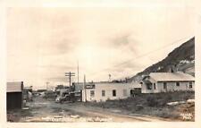 RPPC STREET SCENE KODIAK ALASKA COCA-COLA TRUCK REAL PHOTO POSTCARD (c. 1940s)
