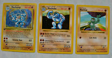 Machamp First Edition, like-new condition Holo Card with Machoke and Machop