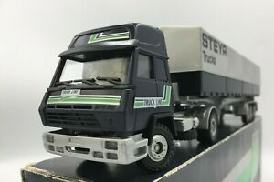 Conrad Steyr Tractor Unit and Tilt Trailer. Comes in Dealer Box. V Rare. 1/50